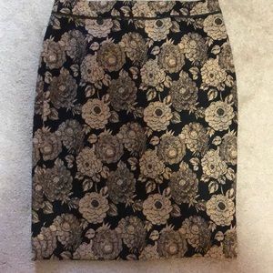 Black and gold flower print pencil skirt.